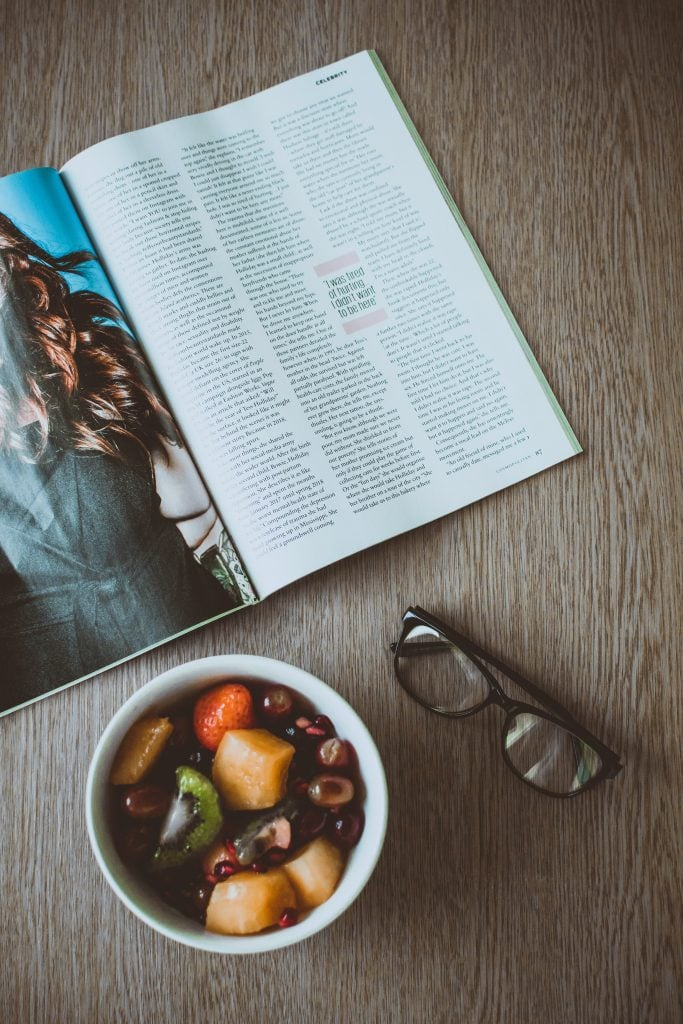 eyeglasses-beside-bowl-of-food-and-magazine-on-table-op-ed