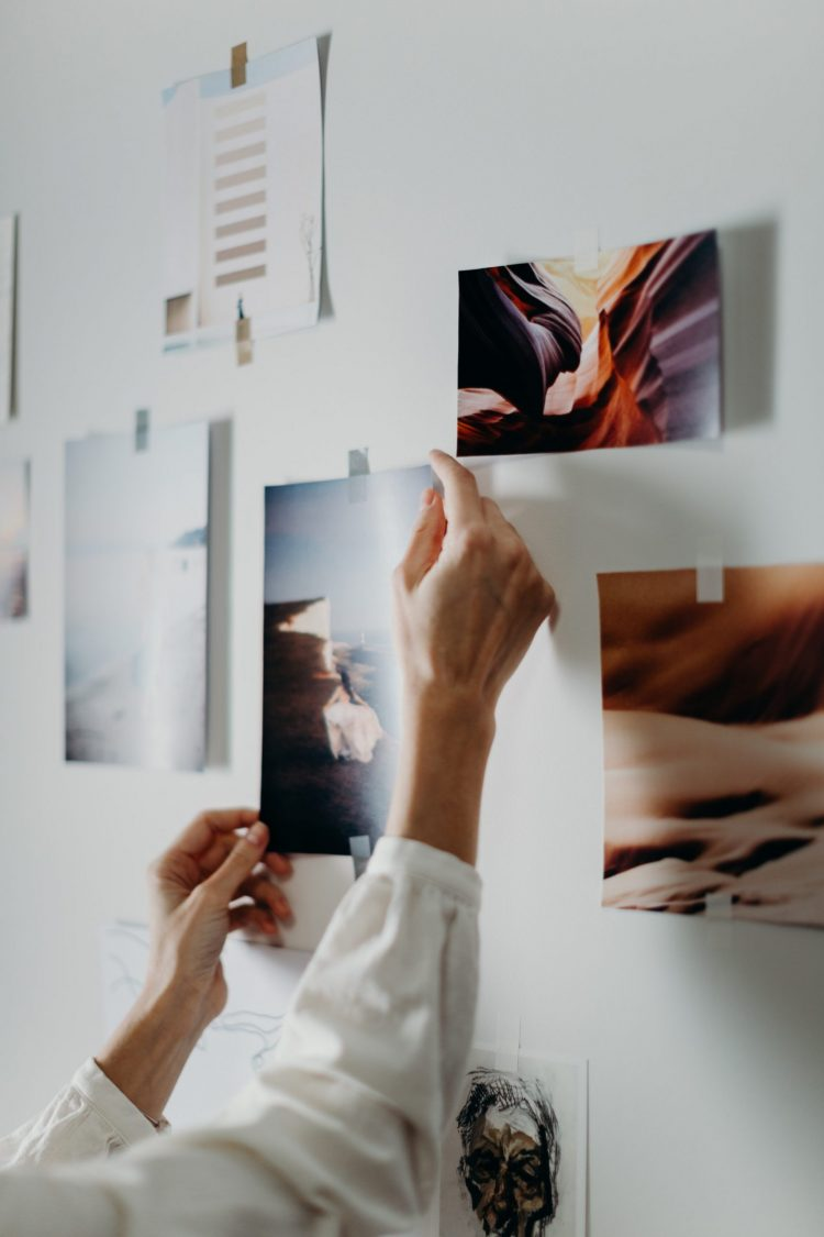 woman putting up images